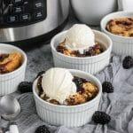 blackberry cobbler dump cake with ice cream scoops on top