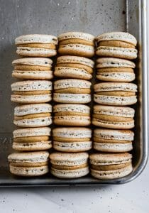 cardamom coffee macarons stacked on a tray