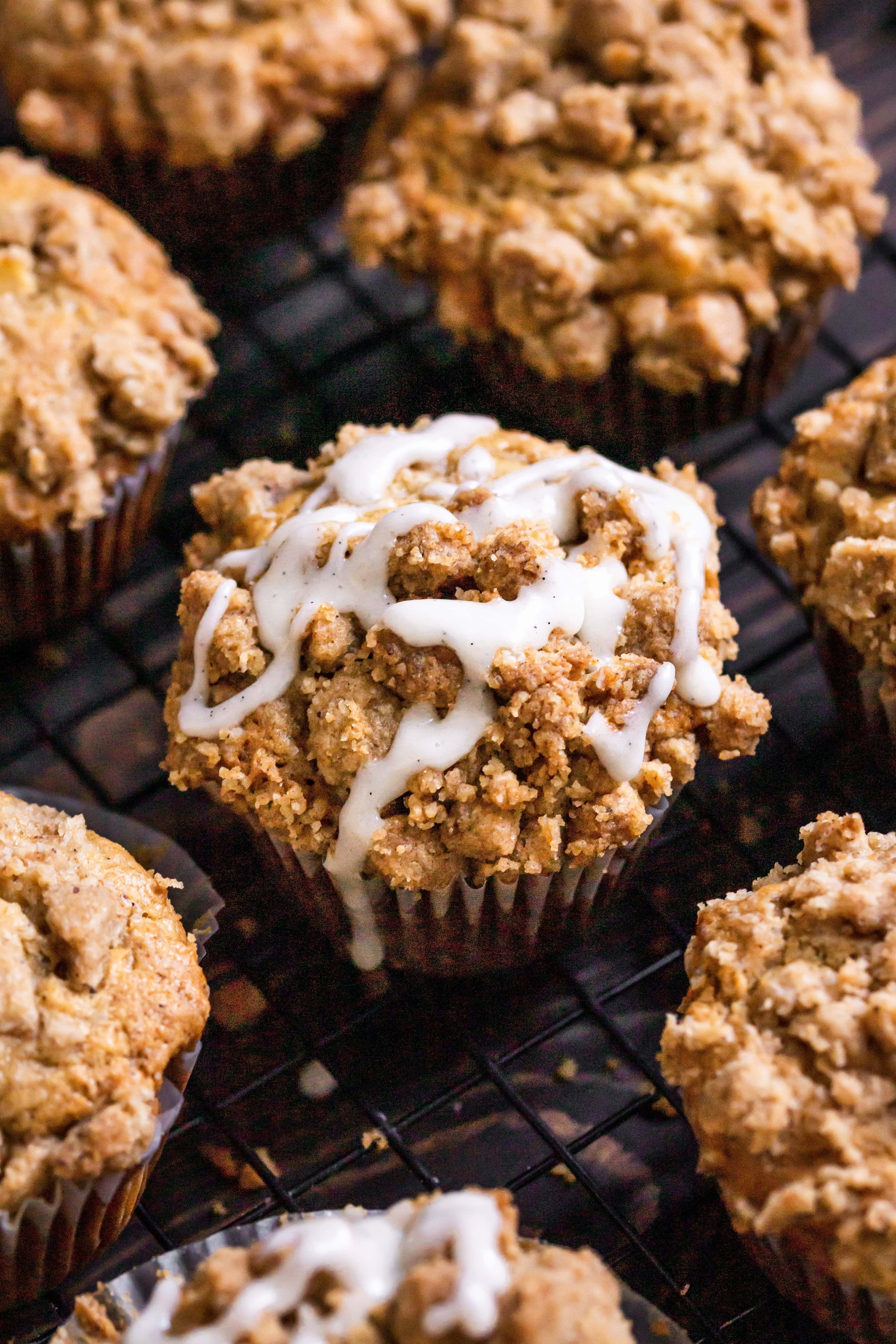 close up of partially glazed apple cinnamon muffins