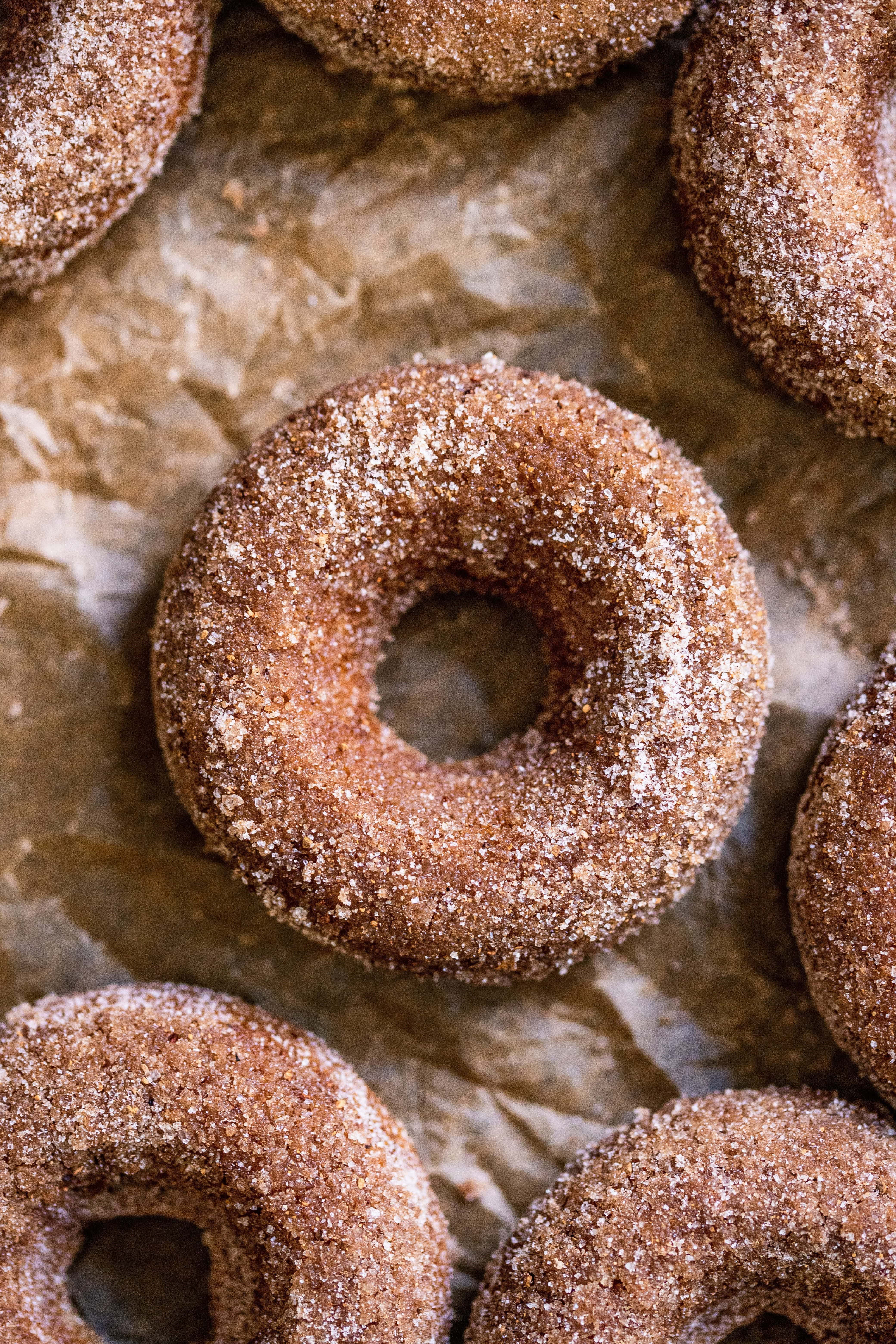 Baked Apple Cider Donuts close up on parchment paper