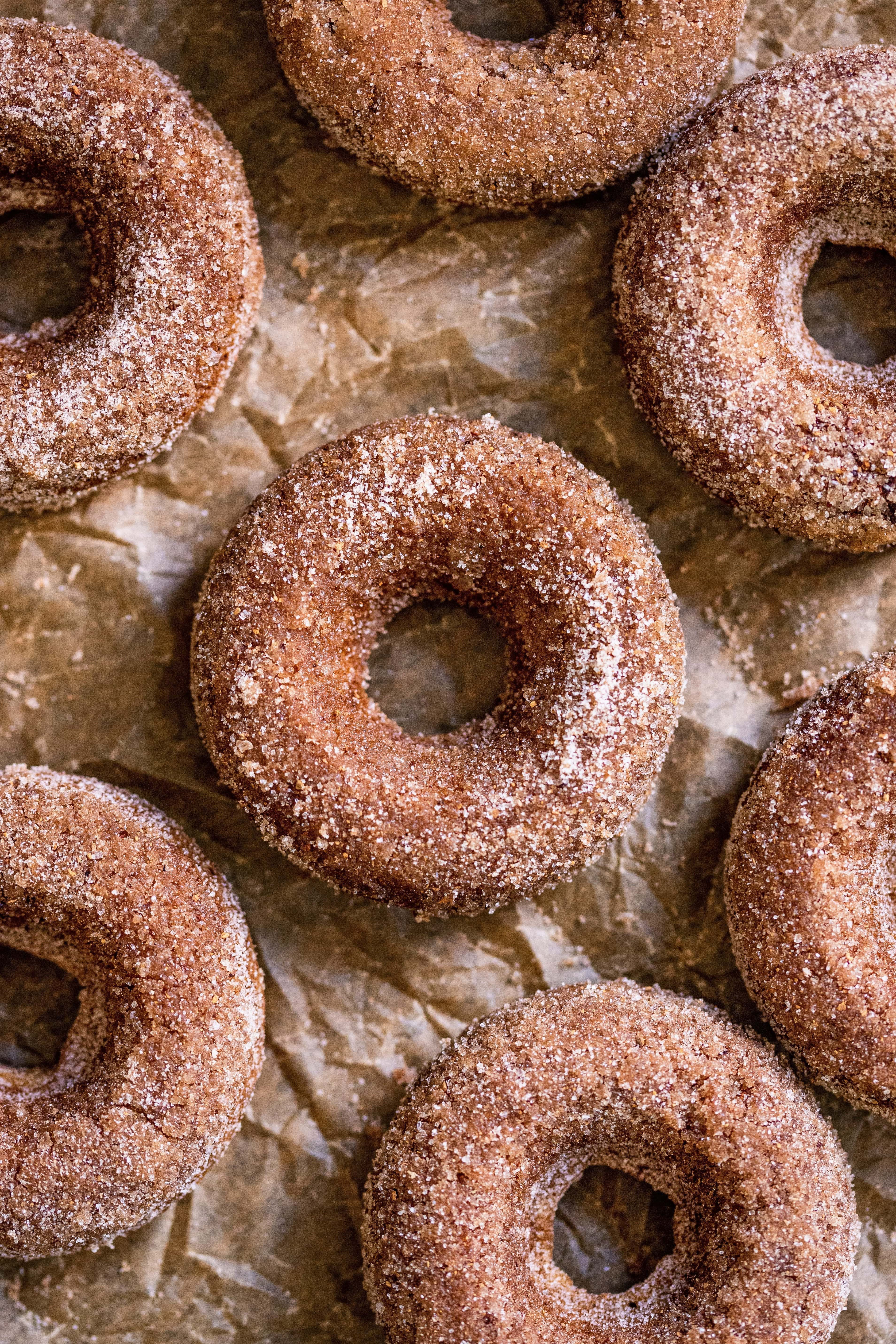 Baked Apple Cider Donuts on top of parchment paper