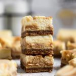 Close up salted caramel cheesecake bars stacked