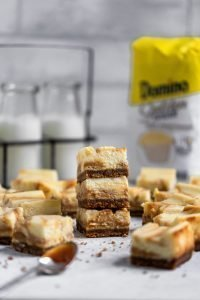 MAIN salted caramel swirl cheesecake bars stacked