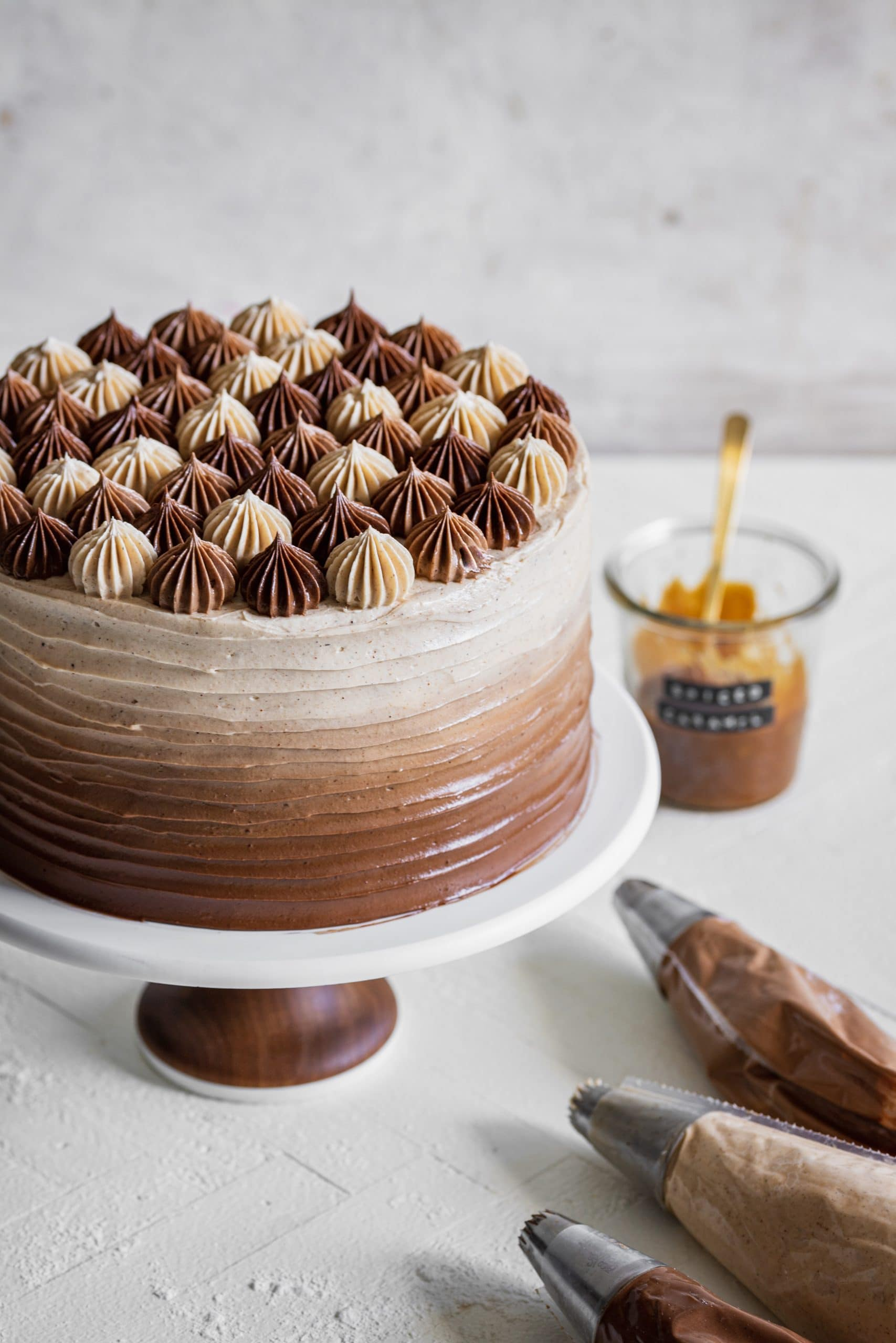 apple cider layer cake with spiced salted caramel swiss meringue buttercream